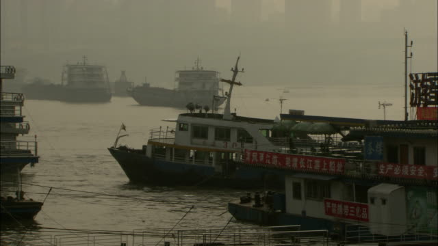 a ferry cruises slowly through a harbor. available in hd. - ferry stock videos & royalty-free footage