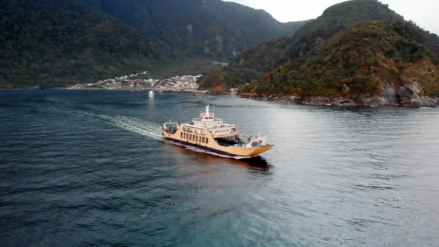 ferry departing from la arena in southern chile - ferry stock videos & royalty-free footage