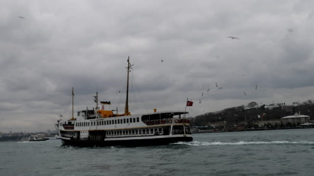 A ferry departs the Karikoy ferry terminal on February 16 2016 in Istanbul Turkey