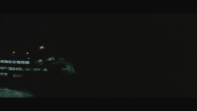 aerial ws ferry illuminated at night - フェリー船点の映像素材/bロール
