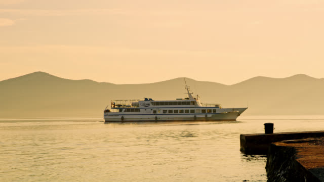 ls ferry leaving a harbor at sunrise - ferry stock videos & royalty-free footage