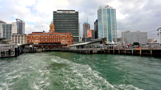 Ferry leaving harbor in Auckland downtown, New Zealand