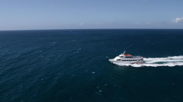 WS AERIAL POV Ferry moving in Morningstar Bay / Charlotte Amalie, Saint Thomas, US Virgin Islands, United States