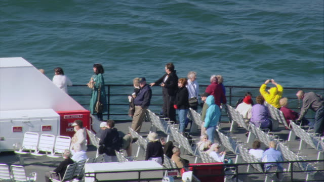 aerial ferry passengers lining the rail and sitting on deck chairs / oak bluffs, massachusetts, united states - ferry deck stock videos & royalty-free footage