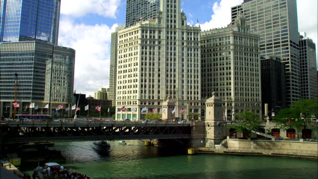 a ferry passes under the michigan avenue bridge in chicago. - michigan avenue bridge stock videos and b-roll footage