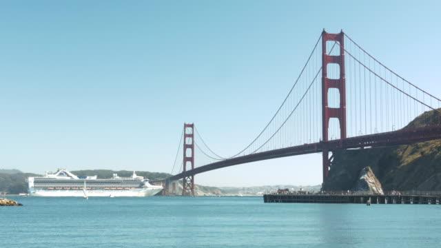 ferry passing golden gate bridge - golden gate bridge stock videos and b-roll footage