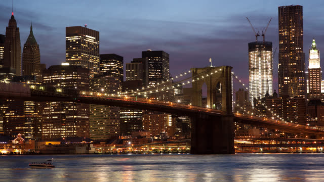 WS T/L Ferry passing under Brooklyn Bridge, modern skyline in background / New York City, New York State, United States