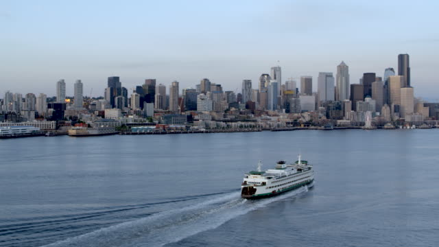 aerial ferry sailing into elliott bay early in the morning - seattle stock-videos und b-roll-filmmaterial
