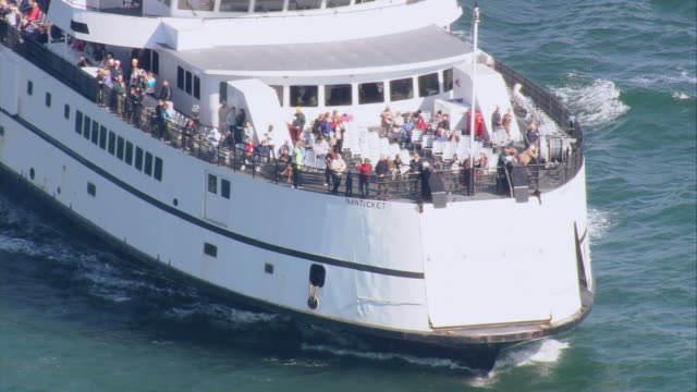 aerial ferry steaming on calm water, with passengers on the rails / oak bluffs, massachusetts, united states - ferry stock videos and b-roll footage