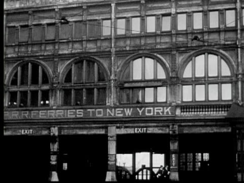 stockvideo's en b-roll-footage met b/w 1933 montage ms ws ferry terminal with ferry approaching then leaving, war ship anchored in distance, jersey city, new jersey state, usa, audio - veerboothaven