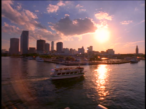 pan ferry traveling along harbor / miami skyline + sunset in background / miami, florida - 1999 stock videos & royalty-free footage