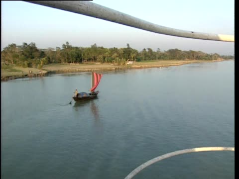 ferry travelling along river passes small fishing boat - bangladesh stock videos & royalty-free footage
