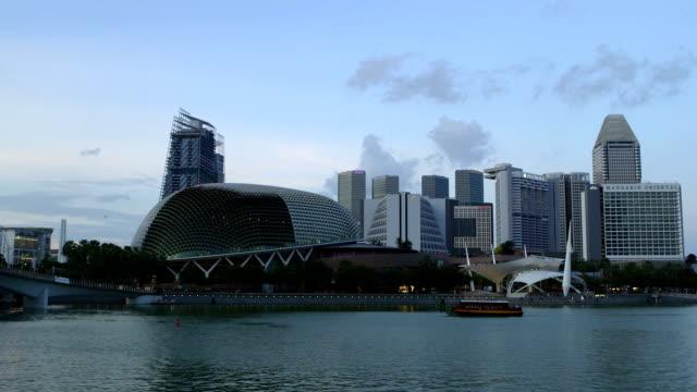 A ferry travels across Marina Bay