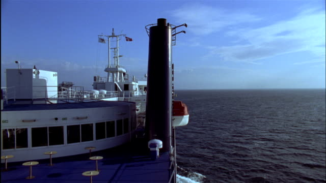 stockvideo's en b-roll-footage met a ferry travels on the open ocean. - ferry