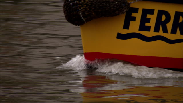 a ferry with bumper tires leaves a wake in bristol harbor. available in hd. - ferry stock videos & royalty-free footage