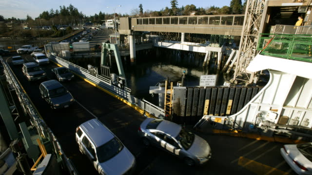 a ferryboat dock loading vehicles - ferry stock videos & royalty-free footage