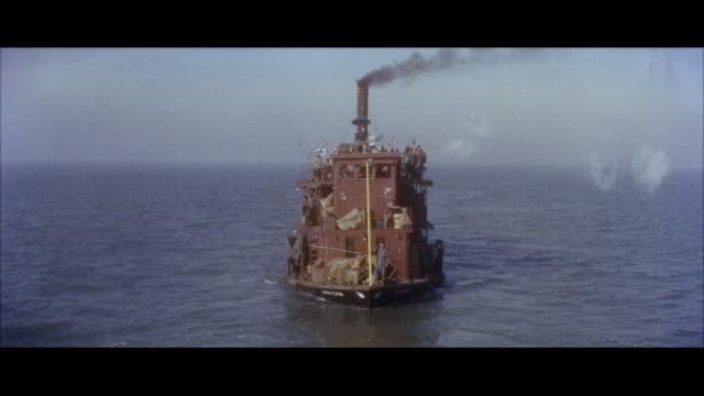 stockvideo's en b-roll-footage met ms pov ferryboat moving in sea / hong kong - breedbeeldformaat