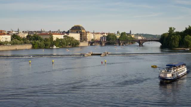 ferryboats navigate near a river vltava spillway in prague. - river vltava stock videos & royalty-free footage