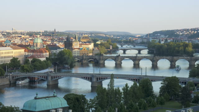 ferryboats navigate under bridges that span the river vltava in prague. - vltava river stock videos & royalty-free footage