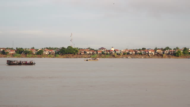 ferryboats passing each other on river