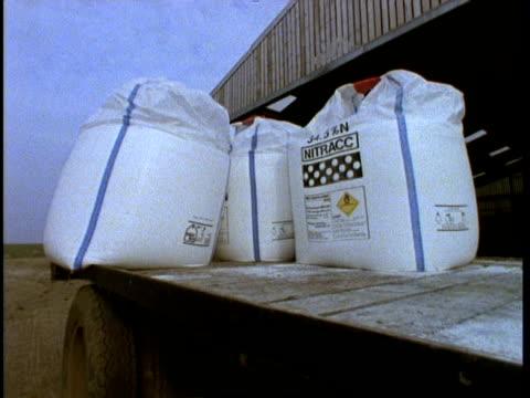 mcu fertilizer sacks on trailer, agriculture - sacca video stock e b–roll
