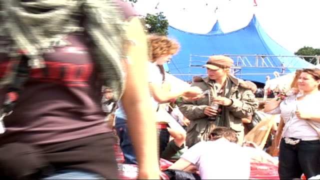 Celebrities Billie Piper chatting to unidentified friends sitting on inflatable chairs as music heard SOT David Tennant standing up with others /...