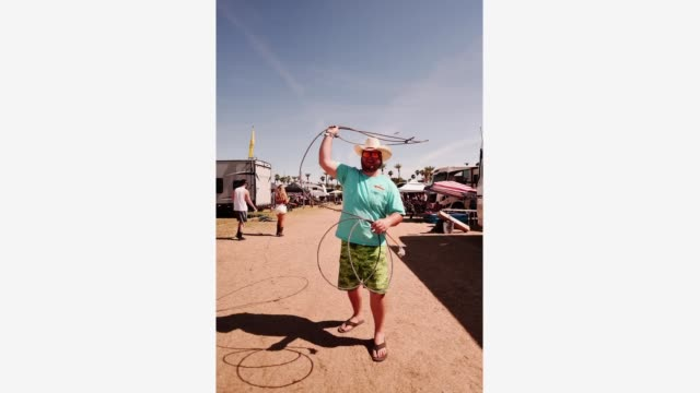 festival goer uses a lasso in the campground during the 2019 stagecoach festival at empire polo field on april 26, 2019 in indio, california. - festival goer stock videos & royalty-free footage