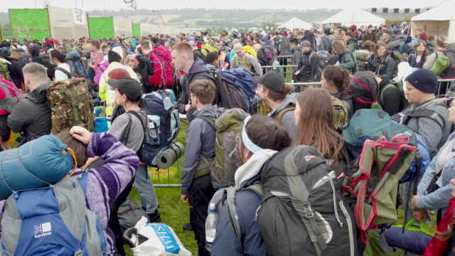 festival goers arrive as the gates open during day one of glastonbury festival at worthy farm, pilton on june 26, 2019 in glastonbury, england. the... - お祭り好き点の映像素材/bロール