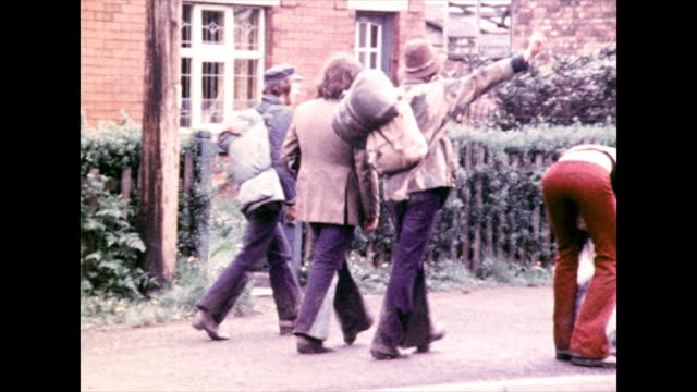 festival goers head home after bickershaw festival; 1972 - skirt stock videos & royalty-free footage