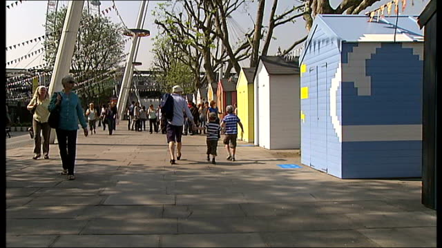 60th anniversary marked on the south bank close shot seagull model high view of stall in shape of giant seagull general view people along past beach... - royal festival hall stock videos and b-roll footage