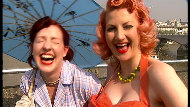 60th anniversary marked on the south bank: general views of exhibition sites; shots of two women, wearing 1950s style dresses, posing for photocall -... - sidecar stock videos & royalty-free footage