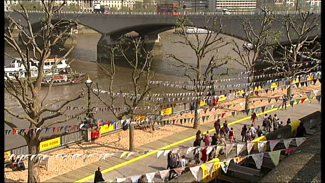 60th anniversary marked on the south bank ** jude kelly interview overlaid sot ** people next to beach huts striped beach hut high view of beach boy... - sommerkleid stock-videos und b-roll-filmmaterial