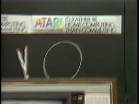 us festival technology exposition tent zoom out from sign stating 'atari computers i'd rather be home computing than commuting' to sony trinitron tv... - sony stock videos & royalty-free footage