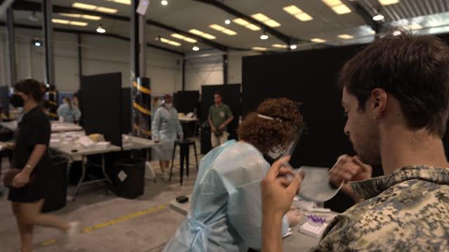 festival-goer takes covid-19 test to attend the vida festival on july 02 in vilanova i la geltru, spain. this is the first festival held in spain... - festival goer stock videos & royalty-free footage