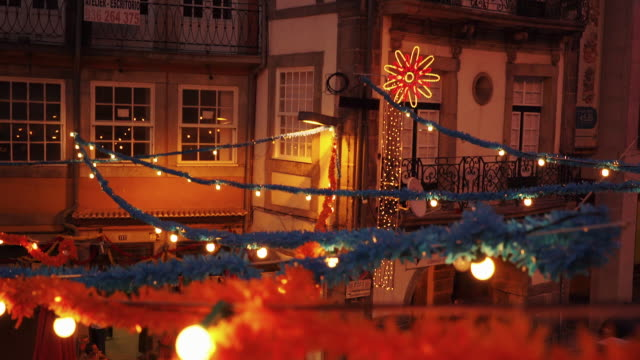 festive decorations on houses in porto, portugal at dusk - portugal stock videos & royalty-free footage