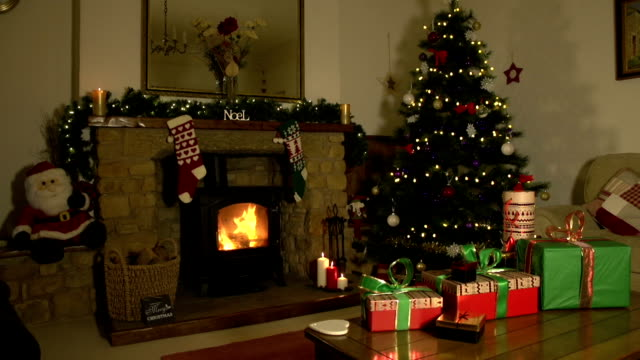 Festive room at Christmas with presents, Tree and Fireplace