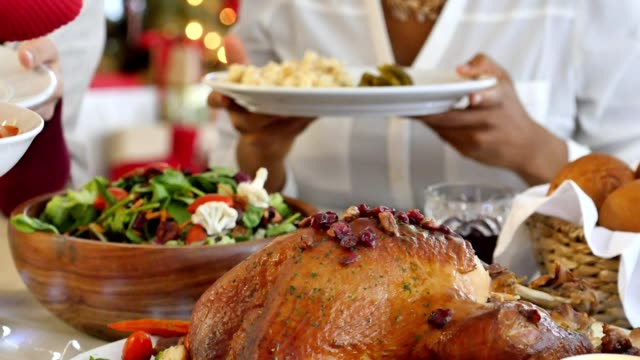 festive table at thanksgiving or christmas dinner - public celebratory event stock videos & royalty-free footage
