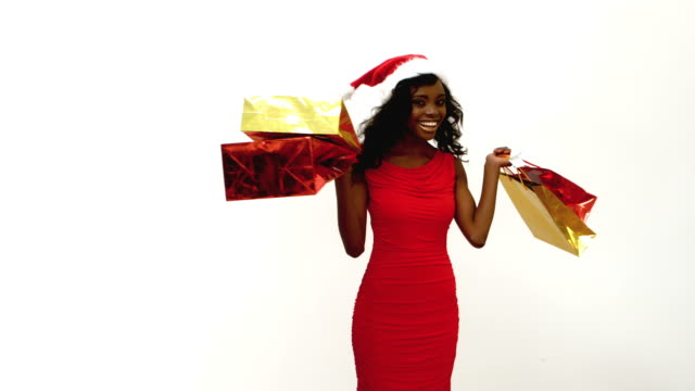festive woman spinning around - santa hat stock videos & royalty-free footage