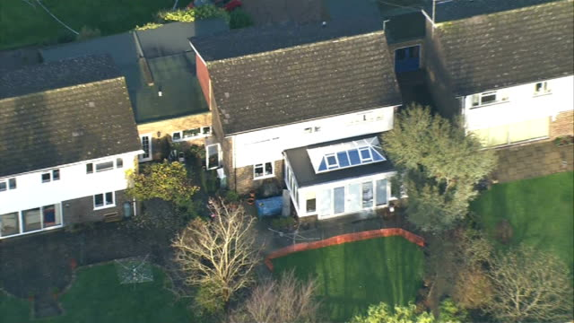 aerials of scene of murder of surrey couple; air views - aerials of crime scene house and surrounding area - surrounding stock videos & royalty-free footage