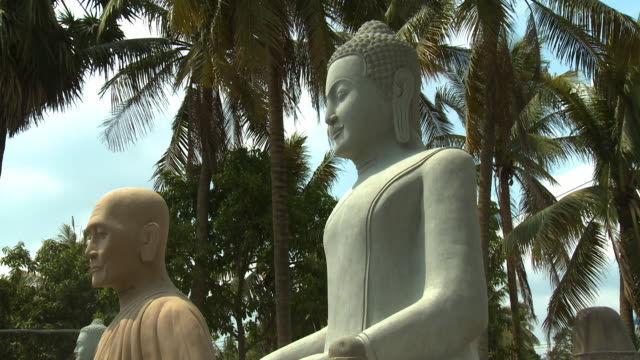 a few buddhist stone statues in san tok, cambodia - effigy stock videos & royalty-free footage