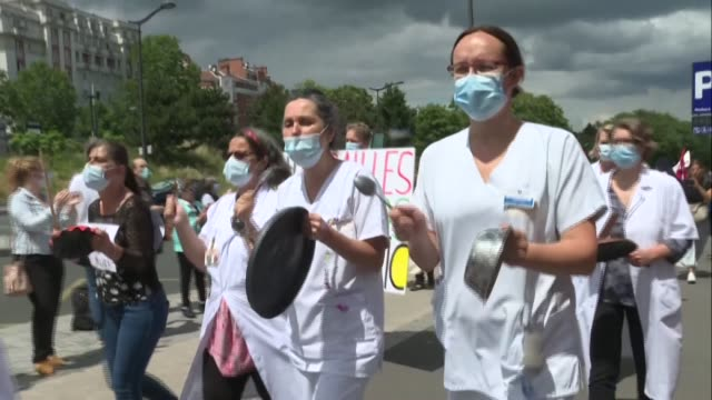 few dozen health workers protest in front of the robert-debré hospital in paris, at the call of the inter-hospitals collective, to demand more funds... - dozen stock videos & royalty-free footage