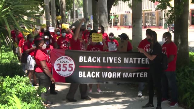"""few dozen miami beach hotel workers hold a """"strike for black lives"""" protest near a covid-19 mass testing site, as thousands lose health insurance... - dozen stock videos & royalty-free footage"""