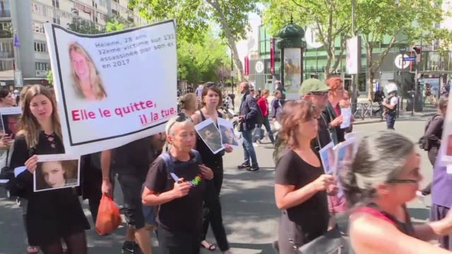 few dozen people, mostly women dressed in black, marched from the grenelle cemetery near matignon at the behest of the femicide by companion or ex... - dozen stock videos & royalty-free footage