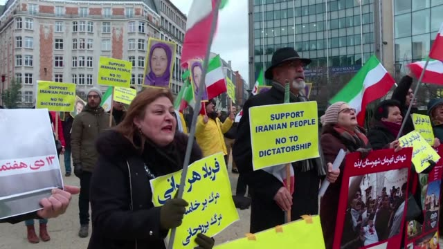 few dozen protesters gathered in brussels in front of the european institutions to show their solidarity with anti regime protesters in iran - dozen stock videos & royalty-free footage