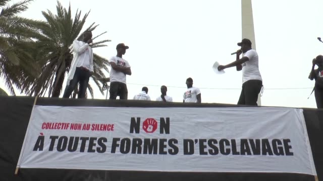 a few dozens of demonstrators gathered in dakar on friday to denounce the rape torture and slavery of thousands of african migrants in libya after... - slavery stock videos & royalty-free footage