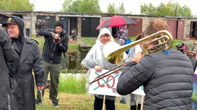 few hundred people from different estonian cities on september 21, 2019 gathered together in unusual place - at boat garages site on the river narva... - asian dub foundation stock videos & royalty-free footage