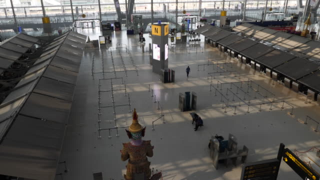 few people in the suvarnabhumi airport after the bangkok government ordered most flights grounded due to the rapid spread if the covid19 virus or... - bangkok stock videos & royalty-free footage