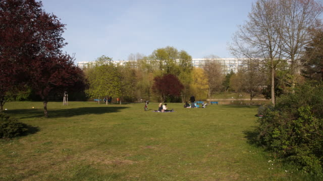 few people spend their leisure time in a berlin park at almost 20 degrees following the tightening of measures affecting public life due to the... - home shopping stock videos & royalty-free footage