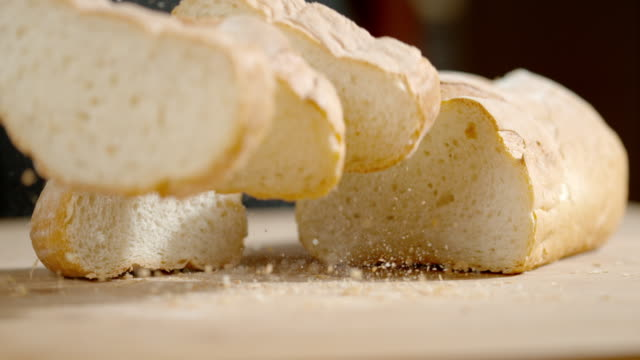 slo mo few slices of bread falling on a table - peasant bread stock videos and b-roll footage