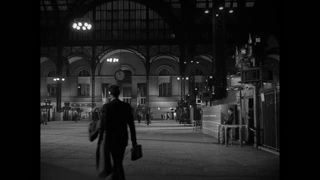 a few travelers and workers walk through new york city's penn station at night. - new york city penn station stock videos & royalty-free footage